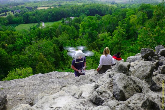 Rattlesnake Point Conservation Area: A group of young people doing drone flight testing atop the Niagara escarpment rock cliff.