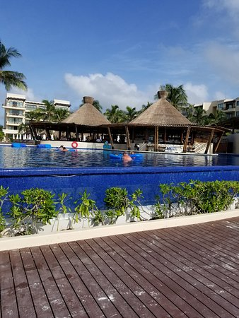 Dreams Riviera Cancun Resort & Spa: there was three pools. Two seemed more for kids. The infinity pool has a swim up bar.