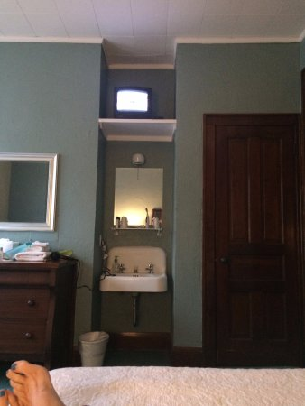 Elkhart Lake, WI: TV the size of an iPad high up on a shelf.