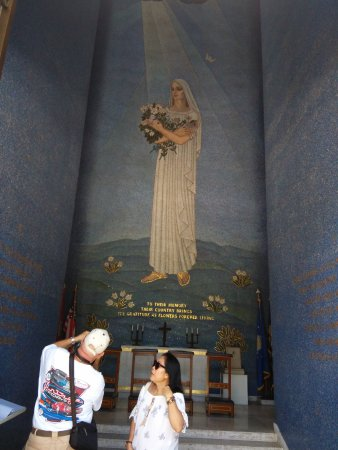 Manila American Cemetery and Memorial: View of inside the Bell Tower with Chapel in the background.