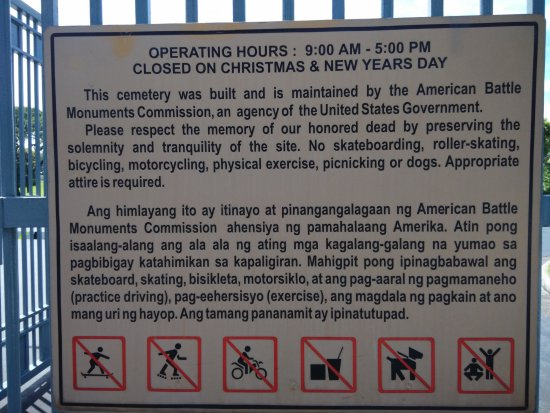 Signage informing visitors of the Manila American Cemetery and Memorial.