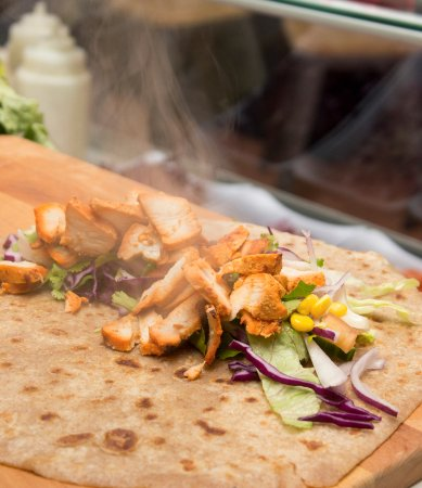 Cranford, UK: Steaming chicken tikka in a wholewheat, handmade paratha