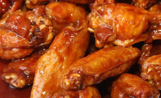 Kenly, NC: traditional fried chicken wings,available in Hot, BBQ and Boom Boom sauce