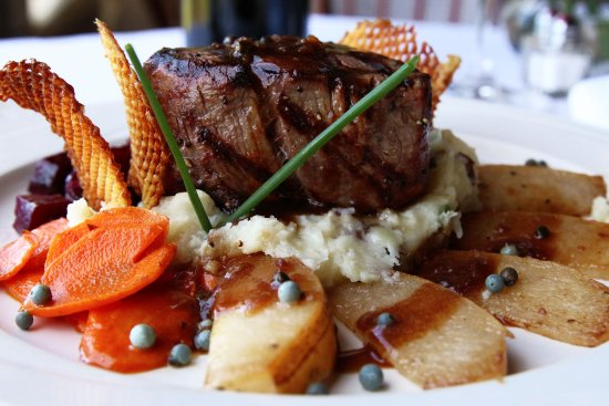 Albion River Inn Restaurant : Grilled Filet Mignon feta cheese gratinée, green peppercorn & shallot reduction, potato-parsnip
