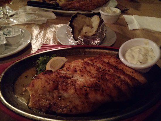 The Grill House: Broiled fish soaking in oil or butter!
