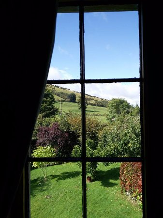 Bucknell, UK: view across the garden from the Brineddin room lounge,to the side of Caer Caradoc