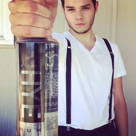 Hye, Τέξας: Nick displaying a bottle of our Silver Rum.