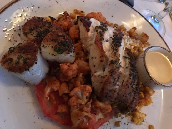 Voyagers Restaurant: Pan roasted grouper and scallops with harissa cauliflower at Voyagers. Delish.