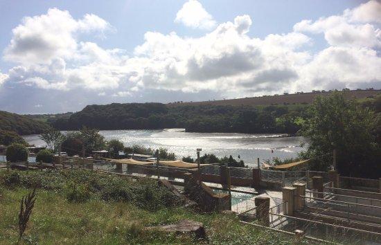 Gweek, UK: View of seal pools with Helford river behind