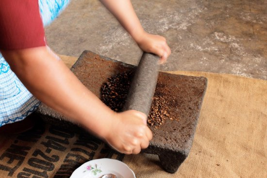Ciudad Vieja, Guatemala: Grinding coffee in the stone (very old school)