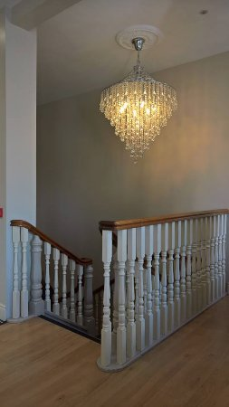 Dromore, UK: ... the stairway, complete with chandelier ...