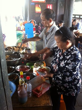 Zhijiang County, China: Small food stall, Longjin Covered Bridge, Hunan province