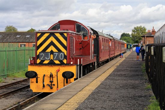 Leeming Bar, UK: A four coach rake pulled by the Class 14 loco in remarkable condition