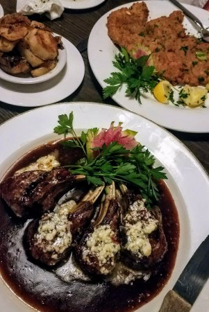 Cadillac, MI: Grilled Lamb Rack with a port wine raspberry demi glaze, and melted Maytag blue cheese butter