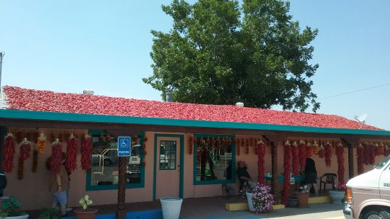 Hatch, NM: Front of store with chiles drying on  the roof.