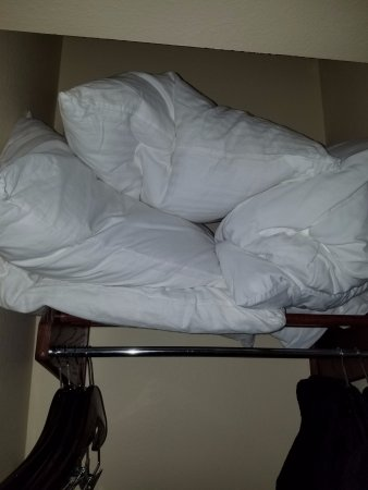 Country Inn & Suites by Radisson, Chicago O'Hare South, IL: Feather pillows shoved onto a closet shelf