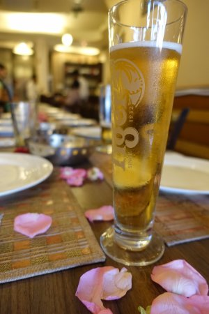 Aromas of India: rose petals on the table and an ice cold beer