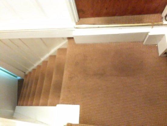 Scorrier, UK: Dirty stairway carpet