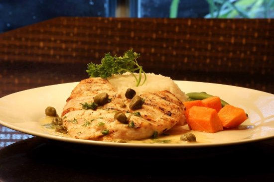 Grilled chicken with creamy herb and capers served with rice and thyme grilled chicken with creamy herb and capers served with rice and vegetables forumfinder Image collections