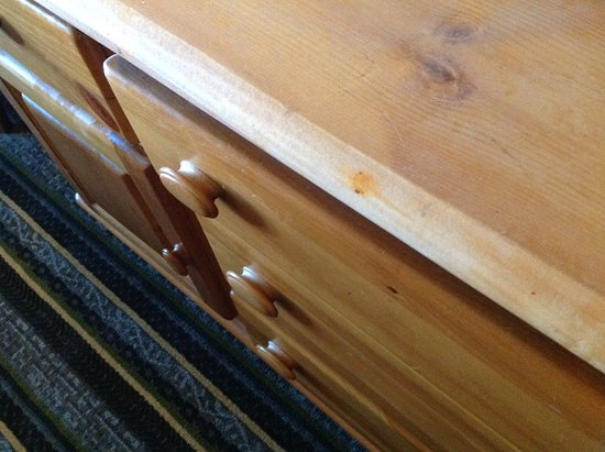 Waunakee, WI: Red stains on dresser