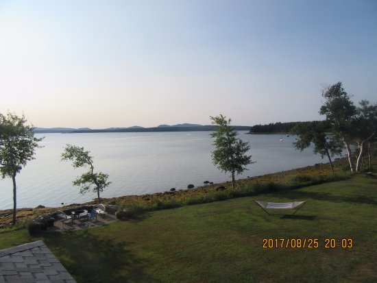 Surry, ME: view from room of fire pit and hammock and Union River Bay