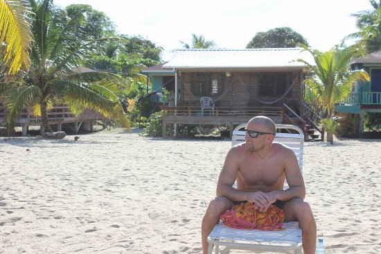 my hubby in front of our cabana in Hopkins Belize
