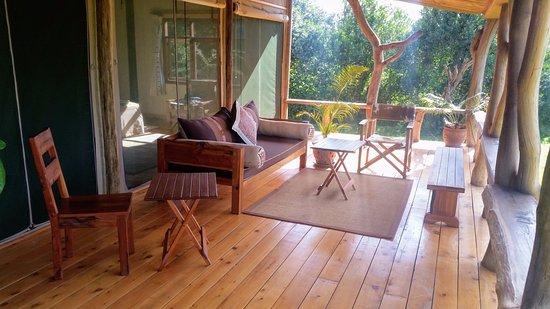 Ol Pejeta Safari Cottages: The spacious, covered veranda has two lovely sitting areas.