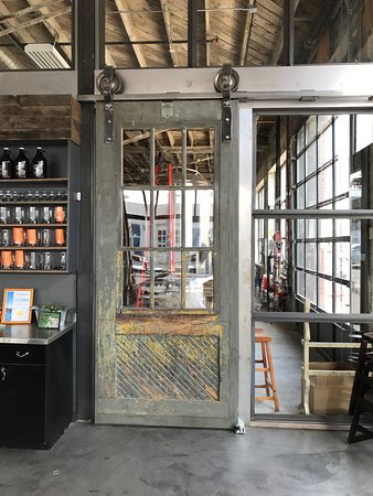 Iron Goat Brewing Co Sliding industrial doors lead to brewery portion & Sliding industrial doors lead to brewery portion - Picture of Iron ...