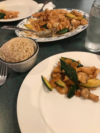 Sammamish, WA: Almond Chicken dish with a side of brown rice.