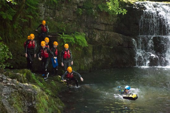Glynneath, UK: A group of Gorge Walkers out with Savage Adventures