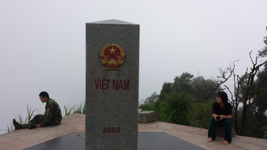 Dien Bien Phu, Vietnam: Điệp (on the right) is in China.  Our (obligatory) escort is in Laos.  Photographer is in Vietn