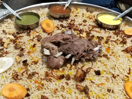 mutton cooked with flavoured rice with raisins and cashew picture