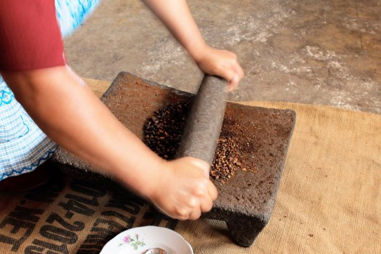 Ciudad Vieja, Guatemala: Coffee grinding process