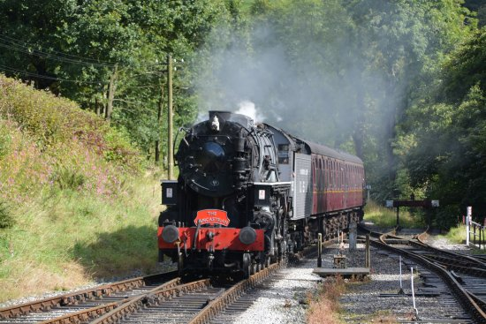Haworth, UK: Steam-hauled service arrives at Oxenhope