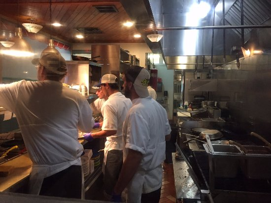 "Kill Devil Grill: The ""line"" at this restaurant---in constant motion. They are the workhorses that make the ""magic"