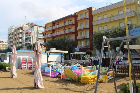 Hotel Marinella is the yellow-ruby building