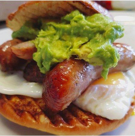 Teddington, UK: Cumberland sausage, egg and crushed avocado brioche