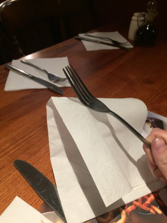 Newhaven, UK: 'Clean cutlery stuck to napkins'