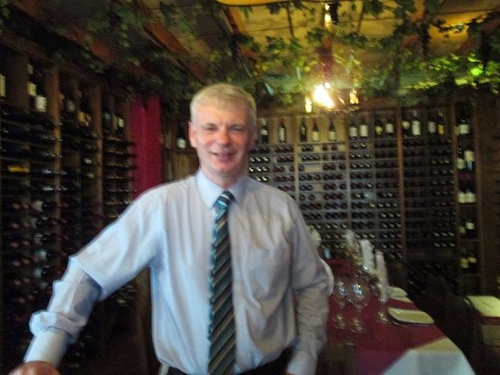 Restaurante Bodega El Mesón del Vino: This photograph is of me in front of the wine racks.