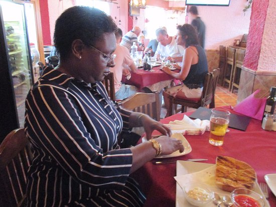Restaurante Bodega El Mesón del Vino: This photograph is of my wife enjoying her meal.