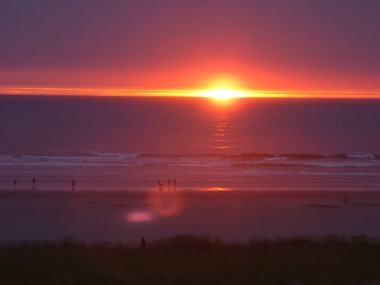 Seaside, OR: looking at the sunset from our hotel room window
