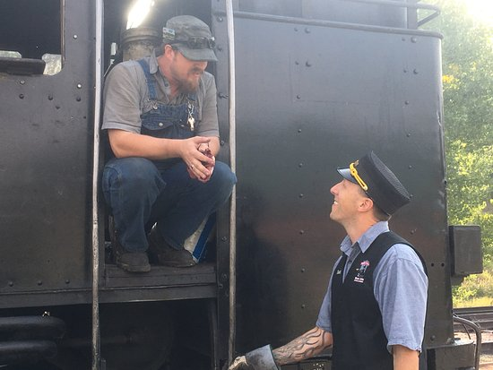 Hill City, SD: Driver and conductor having a chat