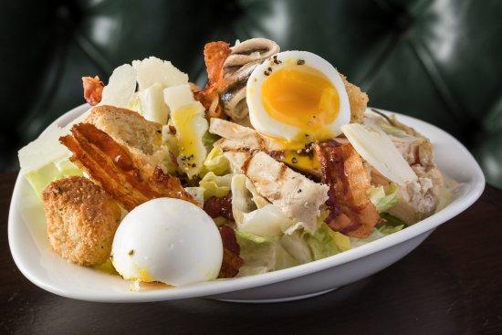 London House: Caesar salad - Chicken, anchovies, bacon, softboil egg, parmesan