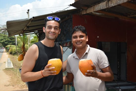 Blessrilanka Tours: With my ever friend Angel from Spain drinking King Coconut.