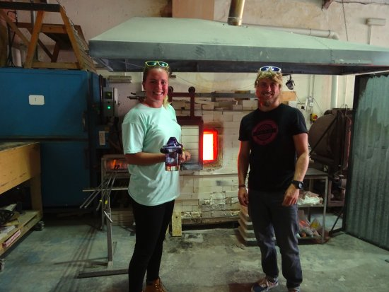 Stuart Wiltshire Glass: With the finished tumbler by the furnace.