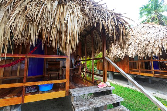 St. George's Caye Resort: Relaxing on the porch of an Oceanfront Cabana