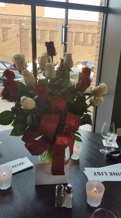 Hastings, NE: our anniversary bouquet at our table at Winestyles. Had the florist (A perfect Gift) Deliver the