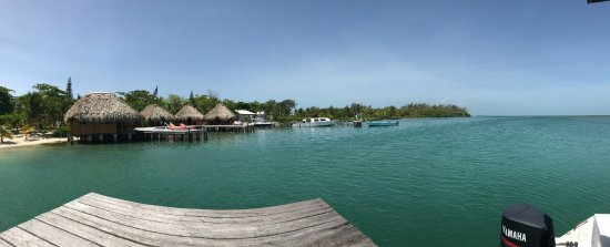 St. George's Caye, Belize: Pano from the dock where you arrive shows the overwater cabanas