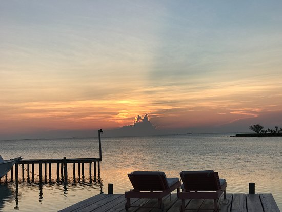 St. George's Caye, เบลีซ: Sunset view from the overwater cabanas.