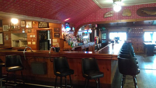 Avon, MN: Bar with vintage red wallpaper.